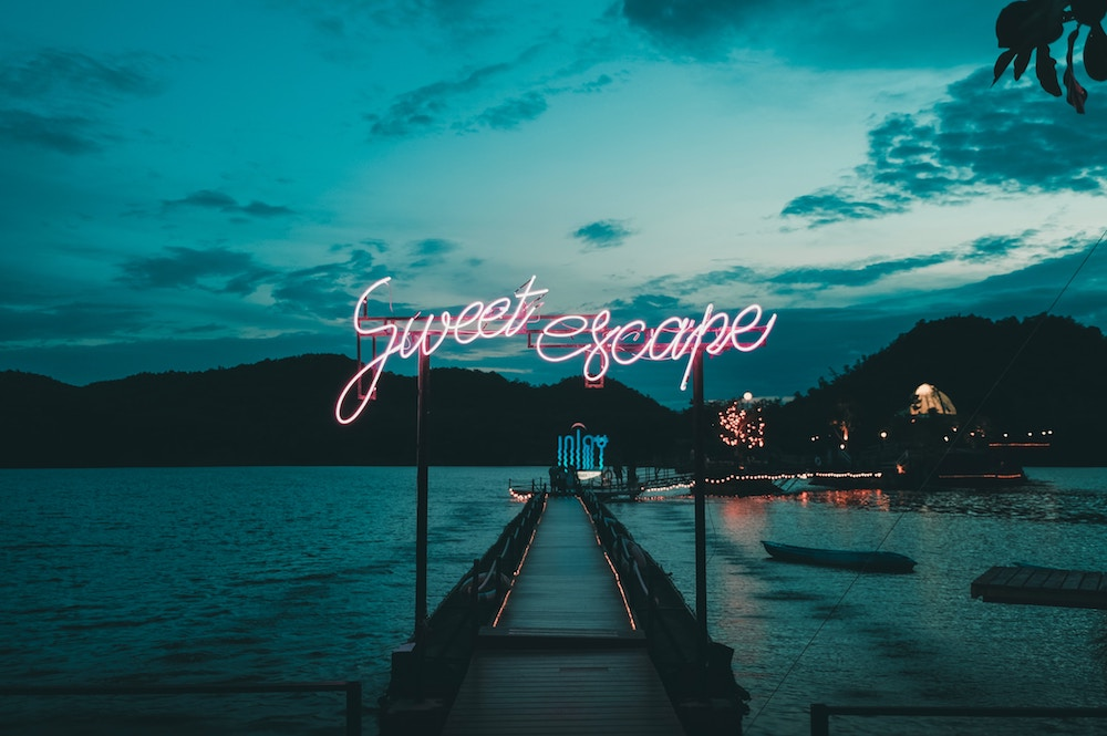 a tropical island with a sign saying sweet escape